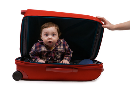 surprised Baby in red suitcase